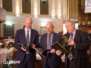 QMCA President, Peter Anusas (centre) reviews the report with Brett Schimming (CSQ) and Steve Abson (IAQ)